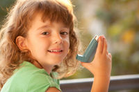 Girl with asthma inhaler